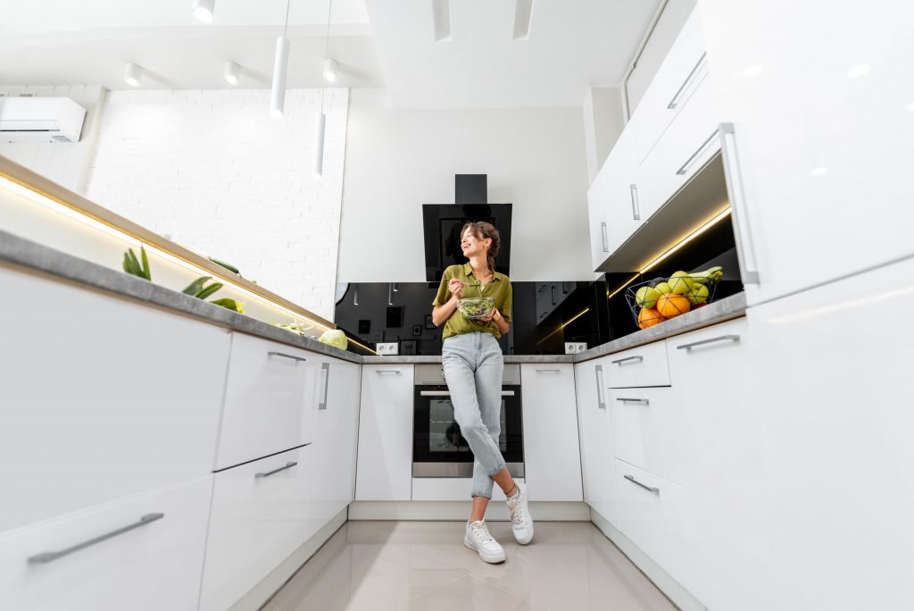 Woman with healthy food on the modern kitchen